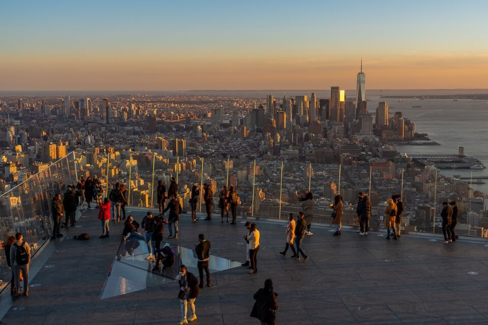 Stunning view of Manhattan and Downtown from Edge NYC observation deck with glass panels and glass floor section at sunset in new york city