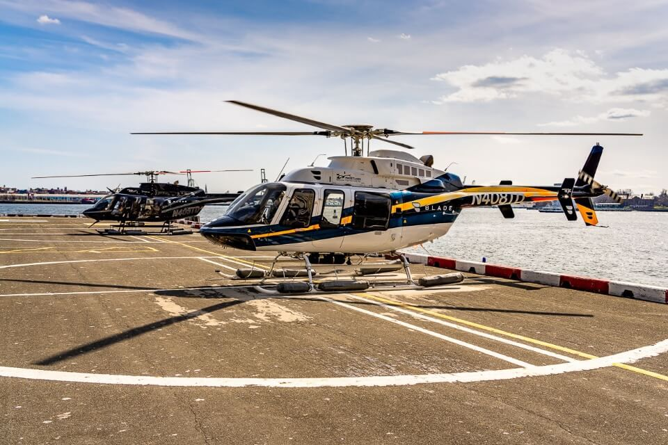 Two helicopters on a helipad in new york city before take off