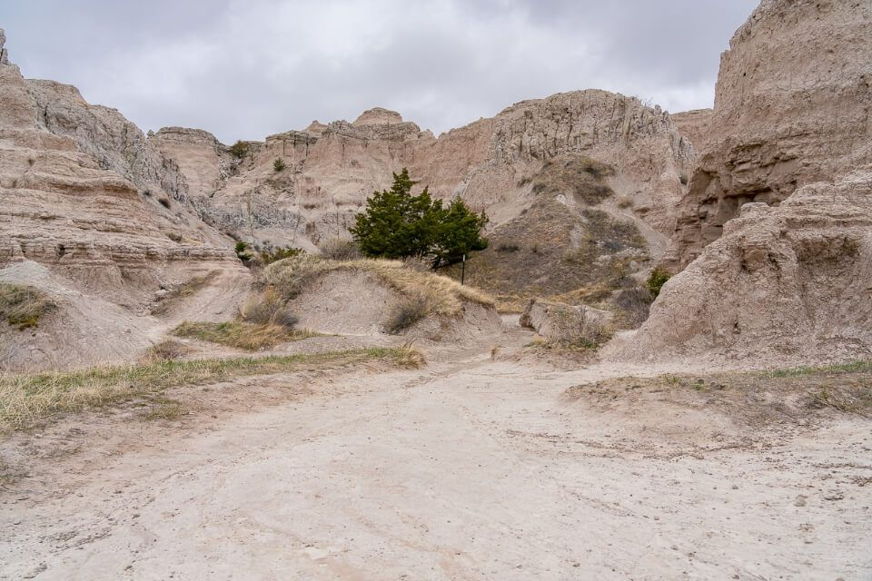 Rocks and dirt path with cloudy sky in south dakota