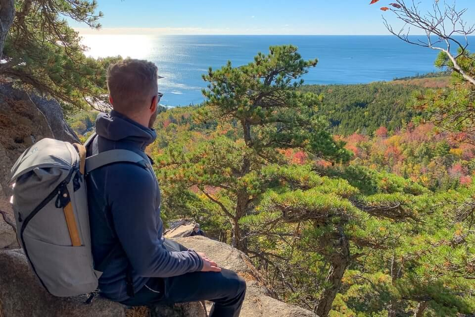 Where Are Those Morgans half way up the beehive trail hike in acadia national park looking out at stunning views over colorful trees and ocean