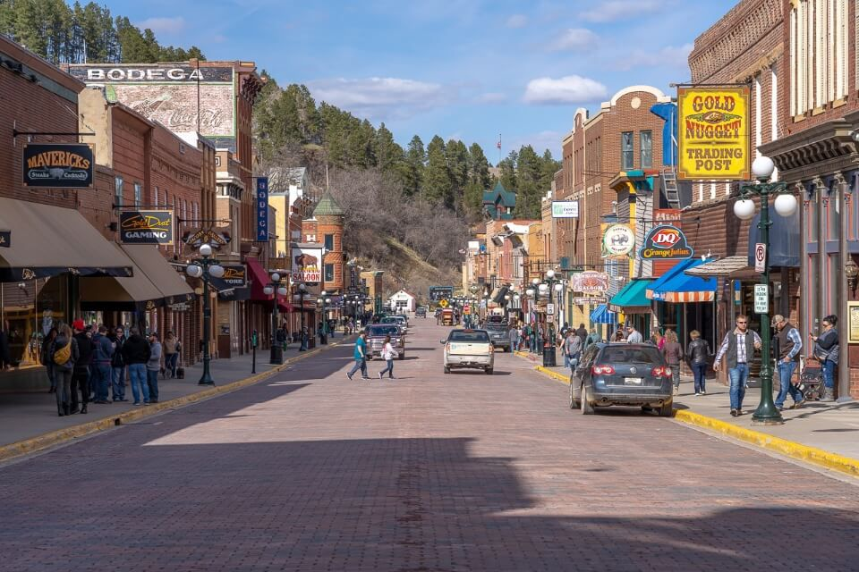 Old historic main street in downtown deadwood south dakota shops wooden facades and tourists