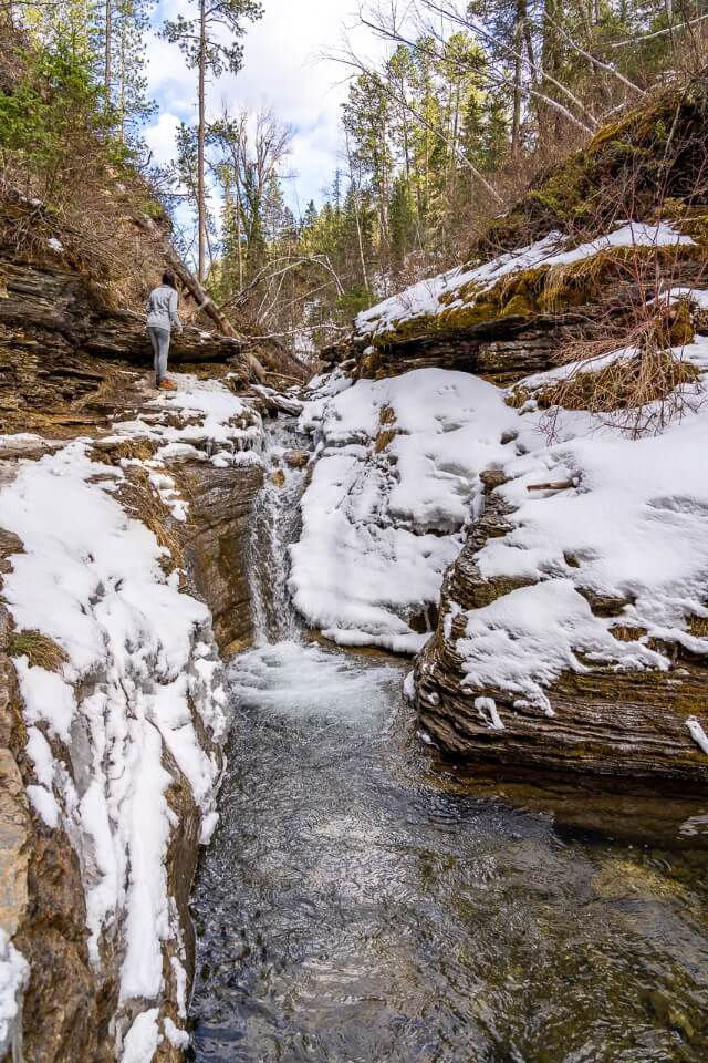 Devils bathtub hiking trail in south dakota spearfish canyon water running with snow around