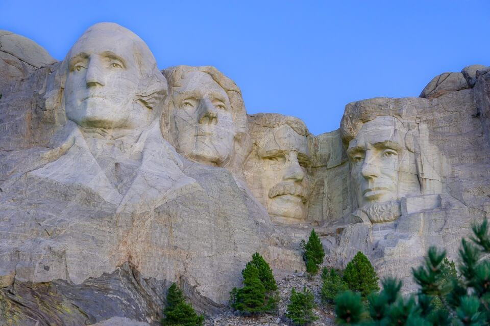 Close up of Mount Rushmore granite without shadows before sunrise gorgeous purple sky