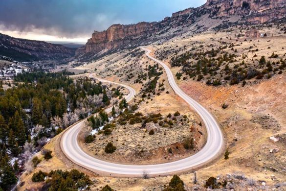 Mount Rushmore to Yellowstone national park road trip itinerary u bend on cloud peak skyway US-16 in wyoming canyon and colorful cloudy sky