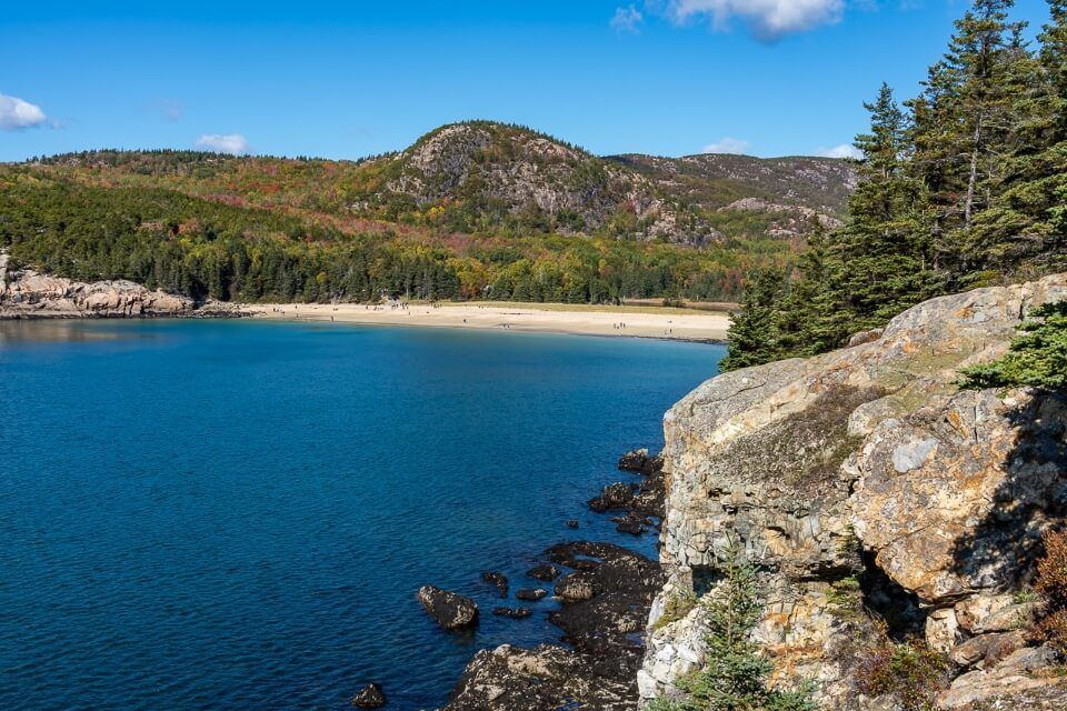 Great Head Trail hugs the coastline with view looking back over sand beach and out to sea