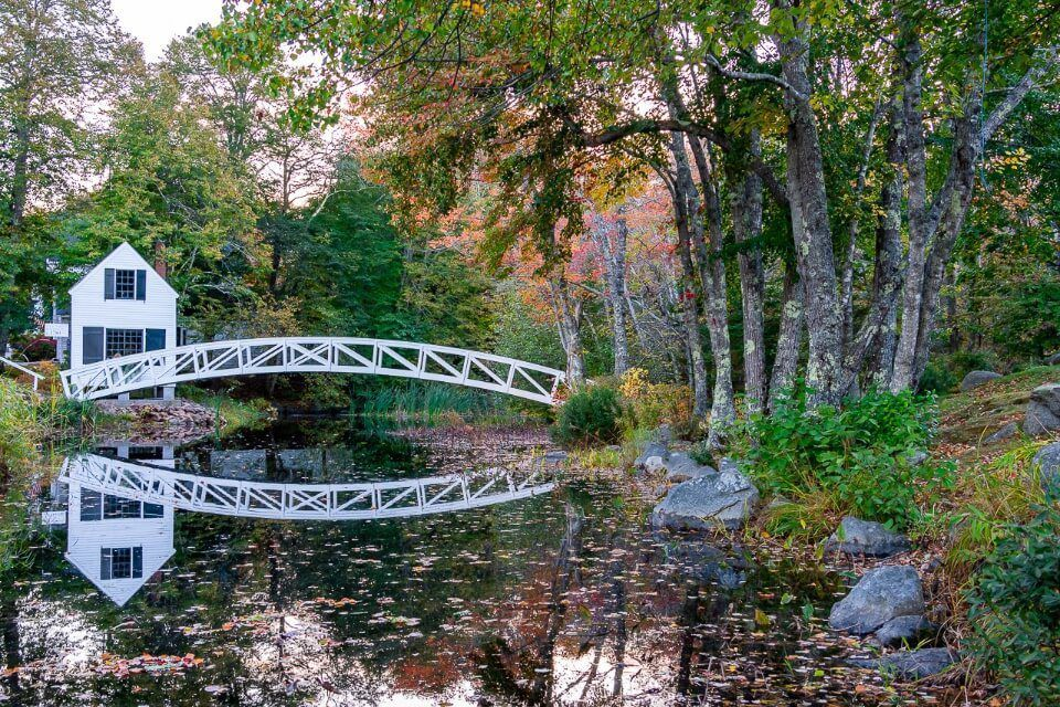 Acadia National Park photography white house and bridge reflecting in Somesville Mt Desert Island.