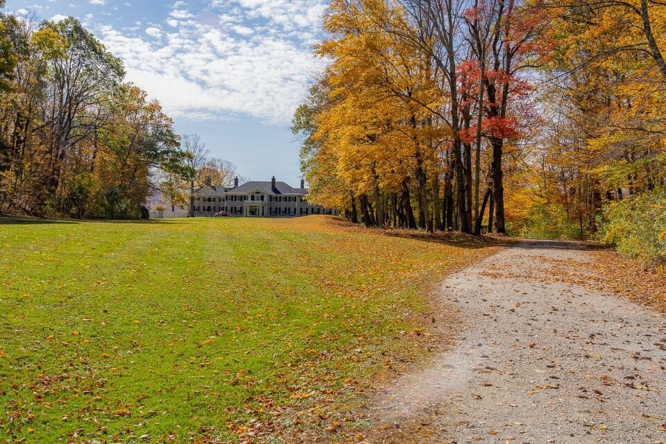 One of the best things to do in manchester VT take a tour of Hildene, the Lincoln Family home road leading through forest and to the manor house in vermont