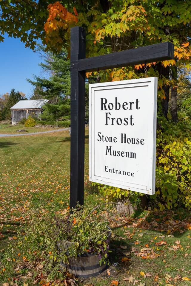 Robert Frost stone house museum sign in fall
