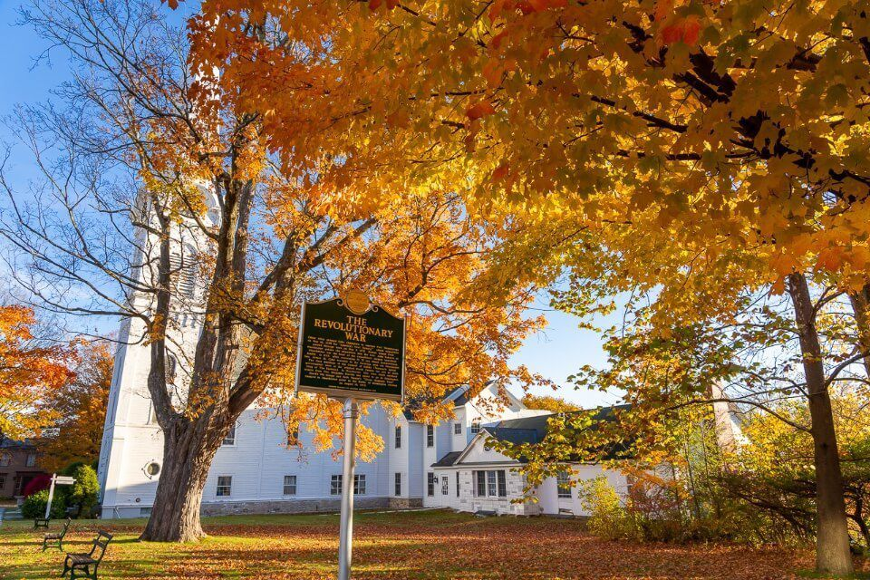 Stunning white church and golden leaves in fall manchester VT best things to do walk around the old town