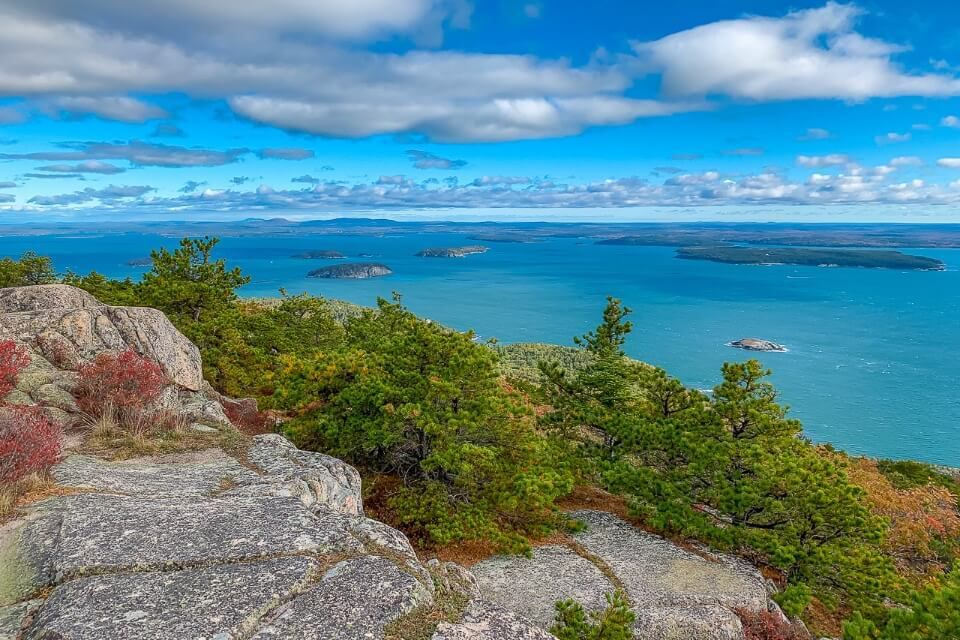 Acadia National Park is one of the best places to visit on a fall new england road trip precipice trail summit looking over ocean