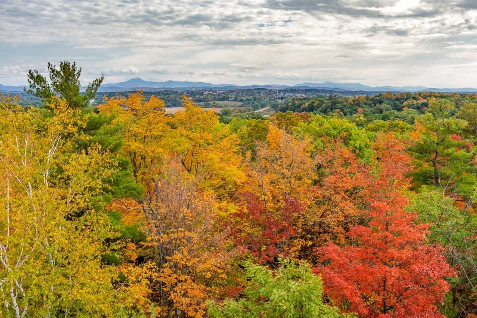 Burlington VT stunning fall foliage colors from Ethan Allen Tower perfect road trip stop in new england