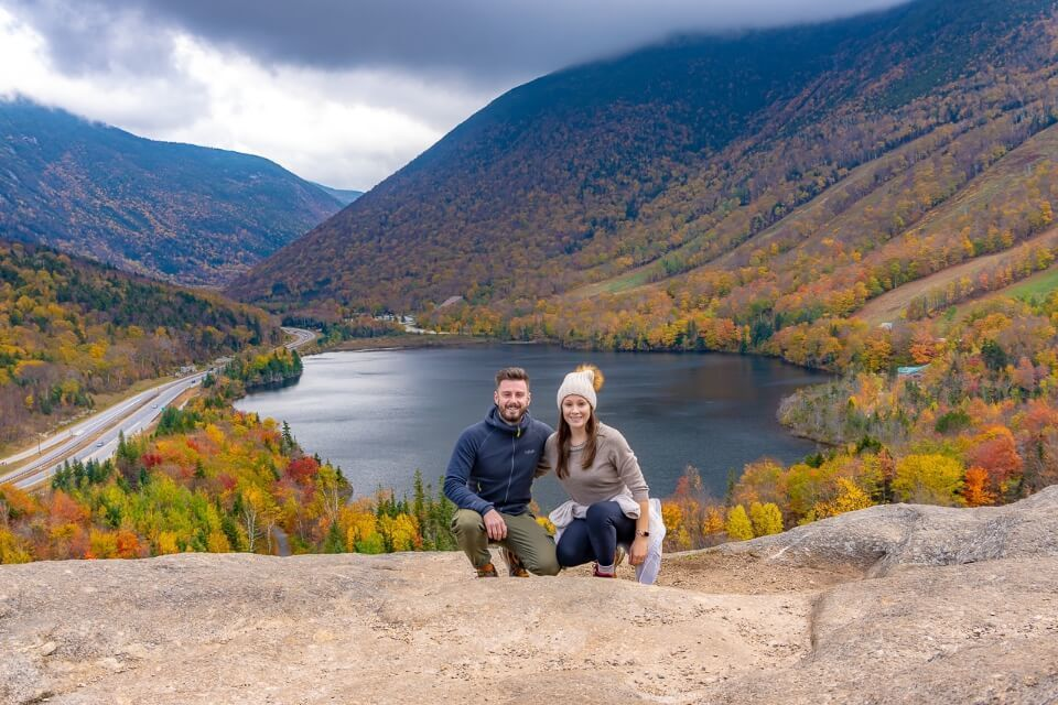 Mark and Kristen Morgan Where Are Those Morgans at Artists Bluff Summit in New Hampshire with Echo Lake background one of the most famous new england fall foliage road trip hikes