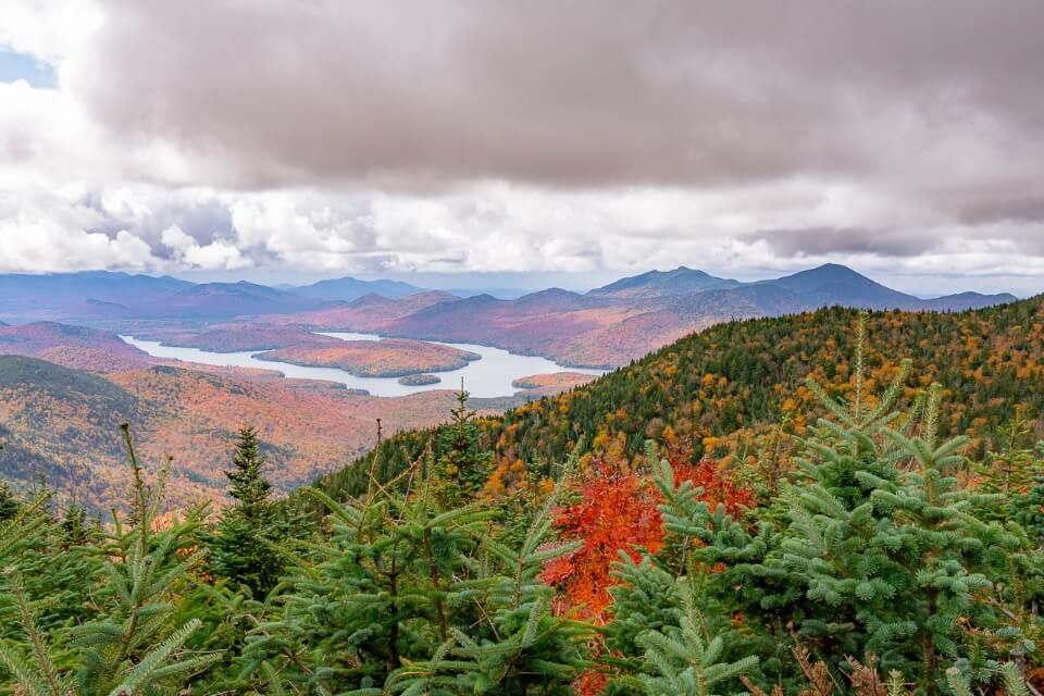 View over Lake Placid NY from Whiteface Mountain with clouds in sky