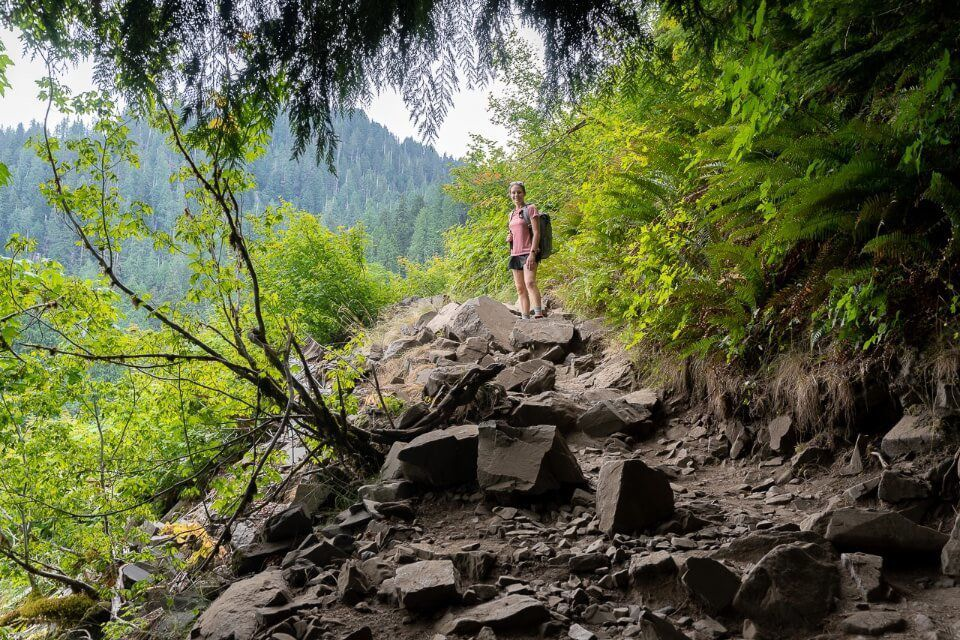 Hiking the Lake 22 trail near granite falls washington rocky trail in shadow from overhanging trees