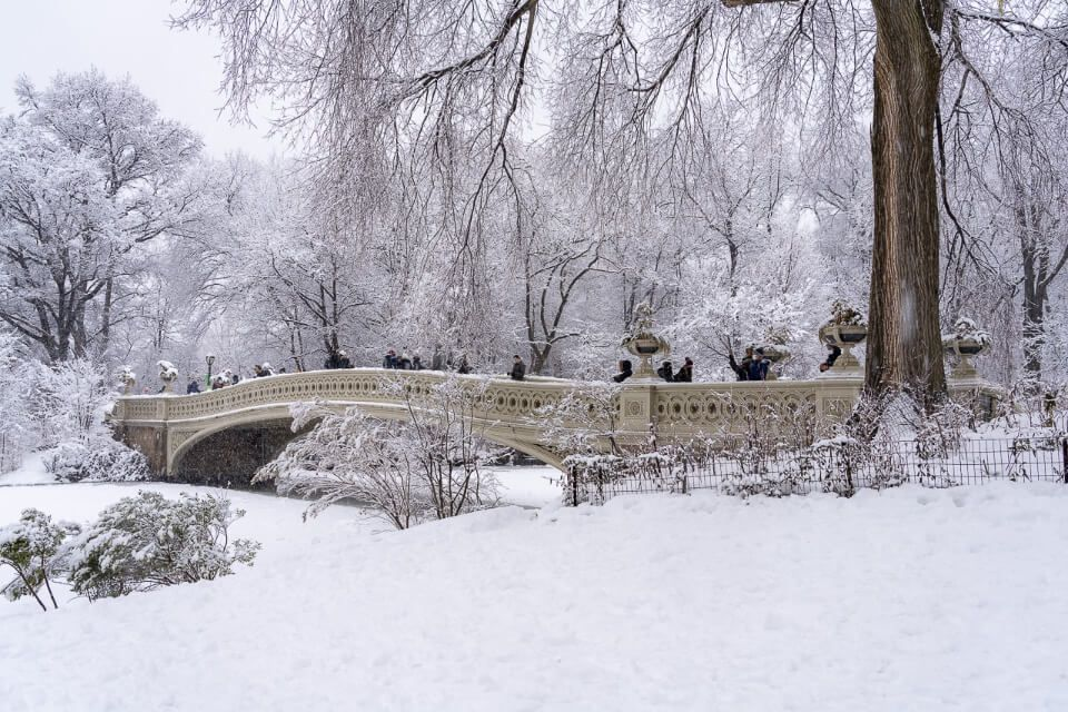 Bow Bridge in snow central park in winter around christmas