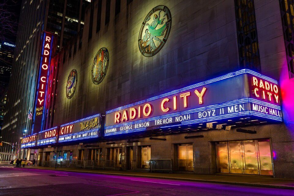 Radio City lights at night Rockettes Show at Christmas in one of the best things to do in NYC in Winter