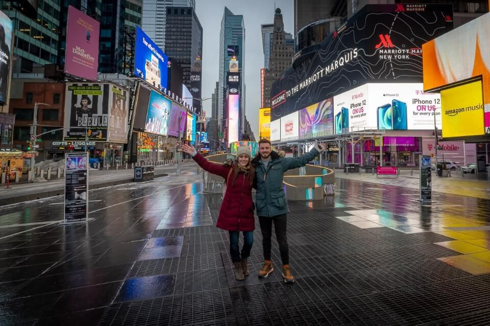Times Square NYC empty where are those morgans standing alone surrounded by lights around christmas in winter