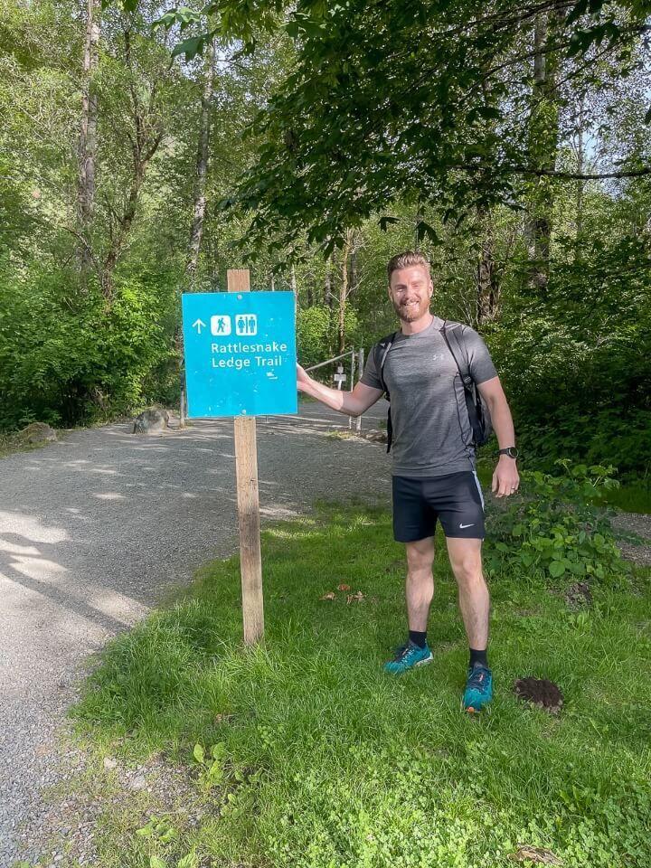 Rattlesnake Ledge Trail Washington Distance Sign Man Pointing Ready To Hike Early Morning