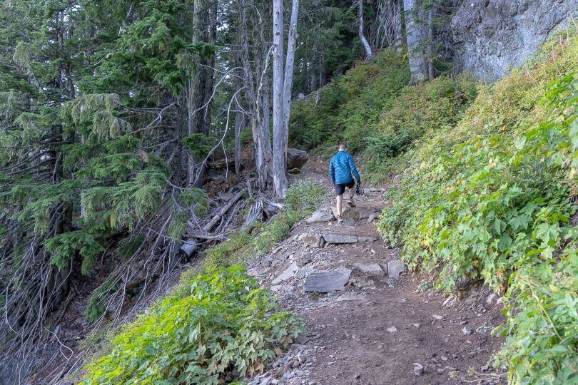 Steep hiking trail man with coat and gloves in washington