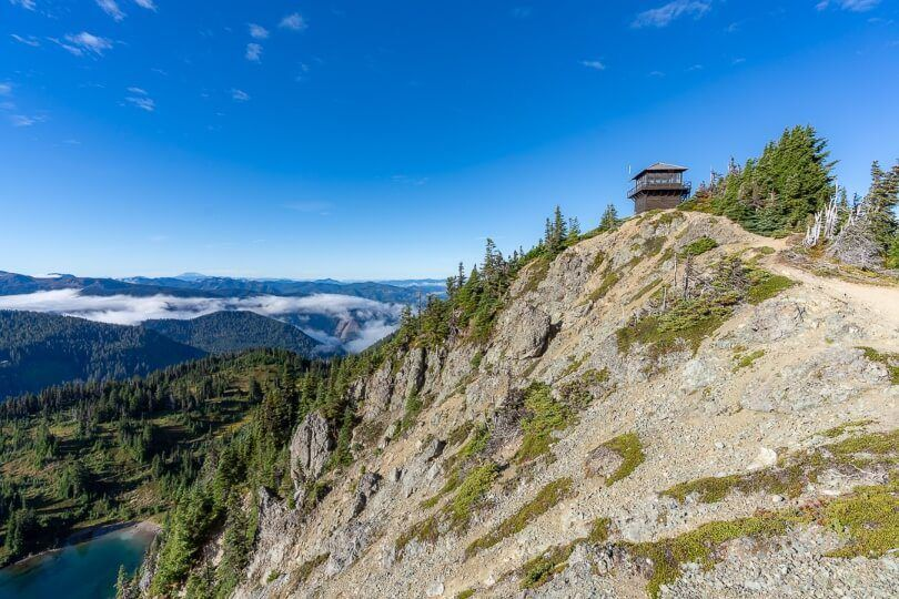 Tolmie Peak Lookout Fire Watchtower high above clouds in valley