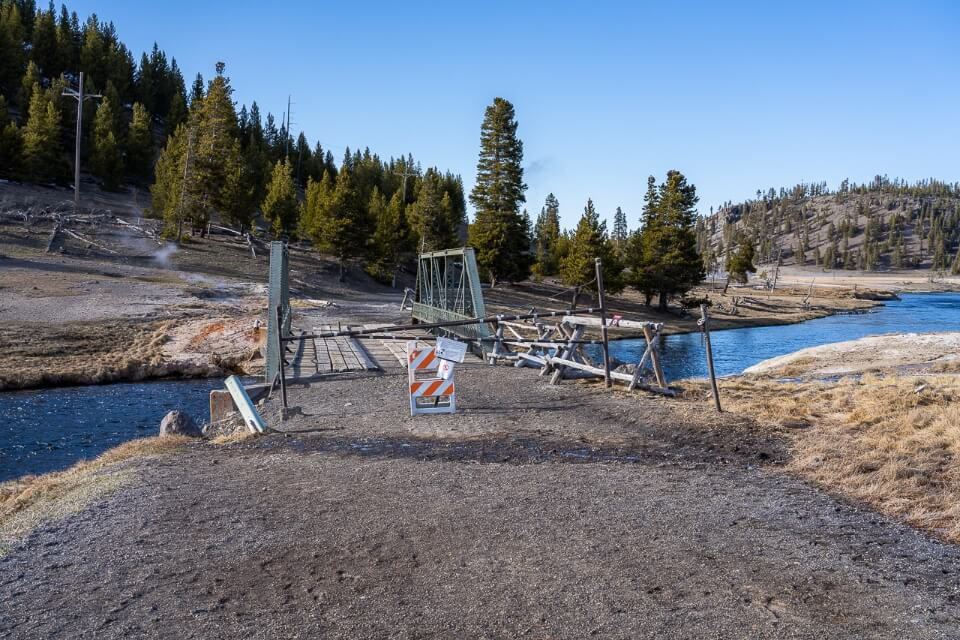 Many hiking trails are closed in yellowstone throughout april due to snow and bear activity like fairy falls with a barricade