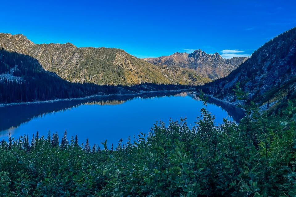 Looking back at Colchuck Lake from Aasgard Pass after sunrise