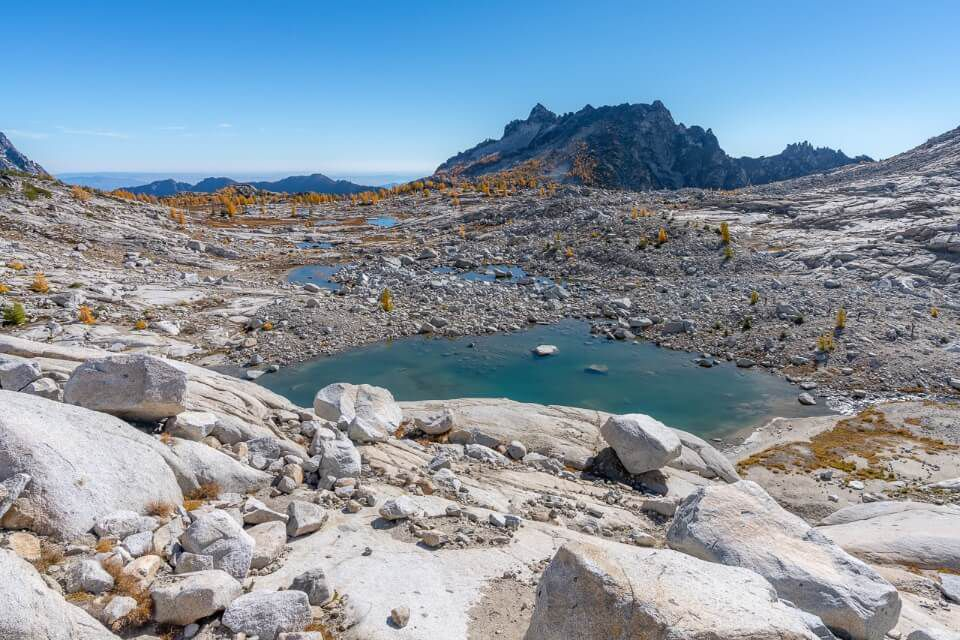 Granite rocks blue lakes and golden larches upper enchantments day hike perfect weather