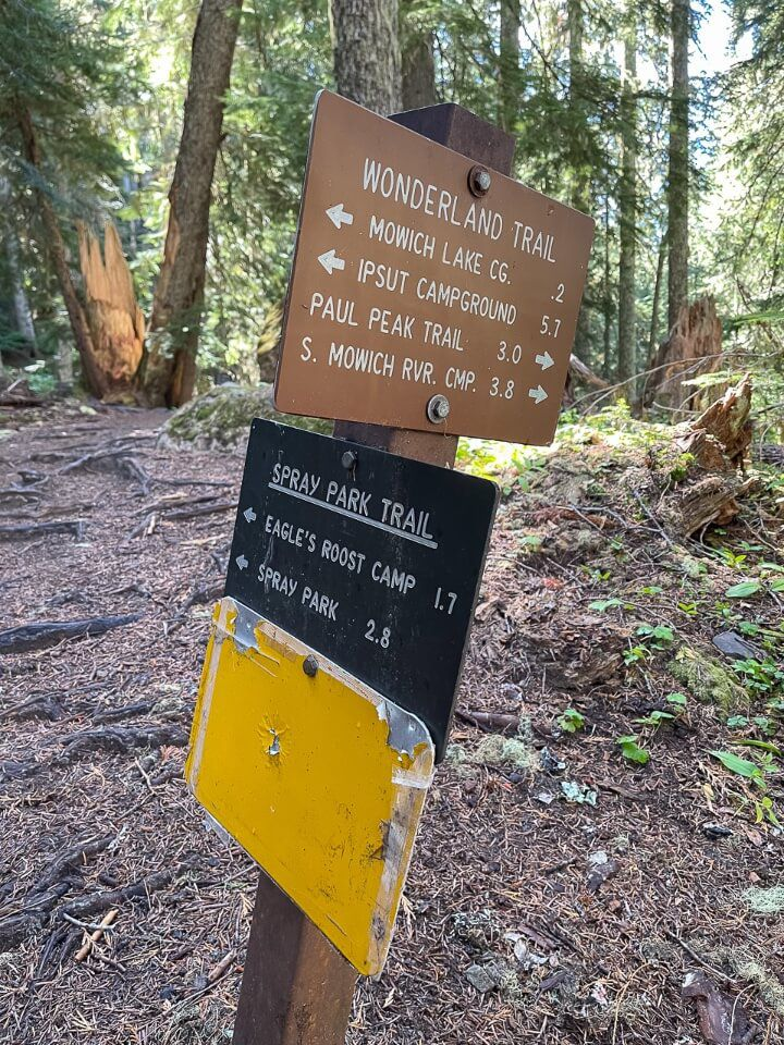 Sign posts with distances on a hike in washington