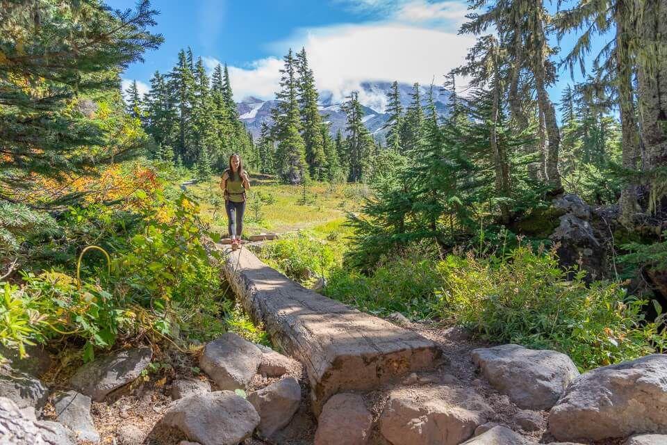 Spray Park trail mt rainier national park stunning meadows with mountain views and wooden bridge
